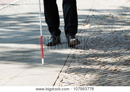 Blind Man With White Stick On Street