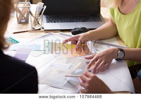 Interior Designers Discussing Project