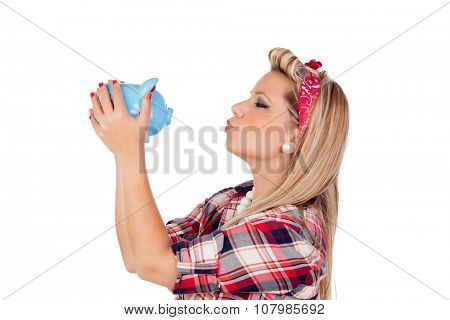 Cute girl kissing a money box in pinup style isolated on a white background