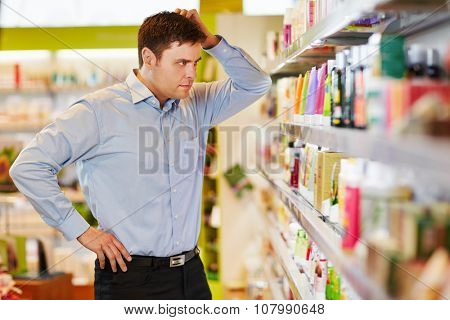 Man wants to do sustainable shopping in a supermarket drugstore