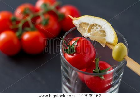 Bloody Mary ingredients on dark stone background