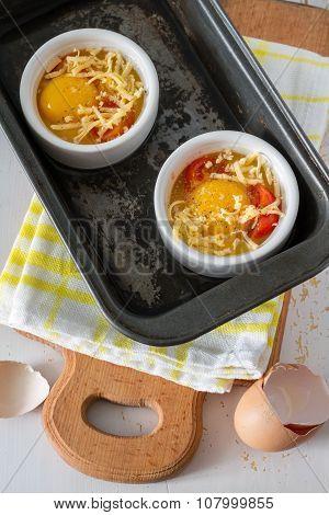Egg cocotte preparation in baking form