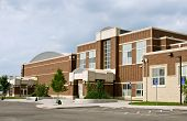 picture of parking lot  - Newly renovated red brick school building on overcast day - JPG