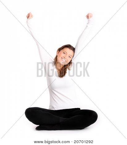 A picture of a young healthy woman stretching and smiling over white background