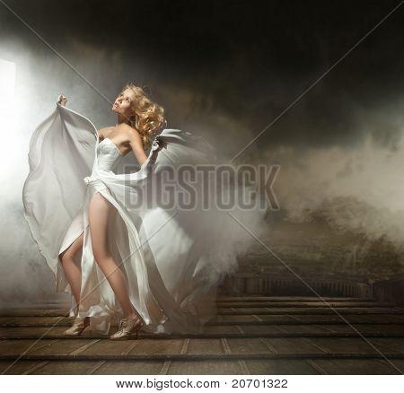 Art photo of a sexy woman in beautiful dress