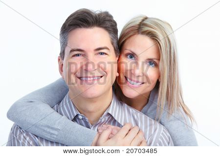 Happy smiling couple in love. Over white background