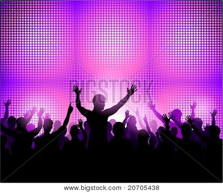Party people dancing on the dance floor. Crowd in front of a stage in a music concert