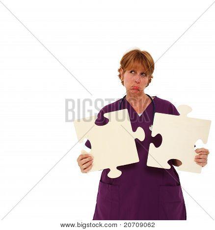 Sad Nurse Holding Puzzle Pieces