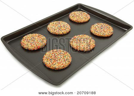 Sugar Cookies With Colorful Sprinkles On Baking Sheet