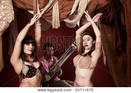 Belly Dancers With Man Playing Sitar