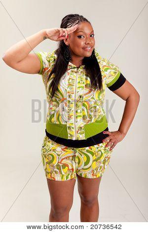 Young Beautiful Black Woman Saluting