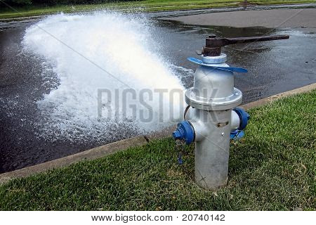 Fire Hydrant Plug Gushing Water