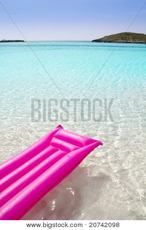 beach floating lounge pink tropical sea Formentera Balearic island