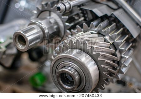 poster of chrome transmission gears of a car motor