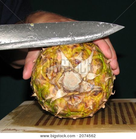 Cutting A Pineapple