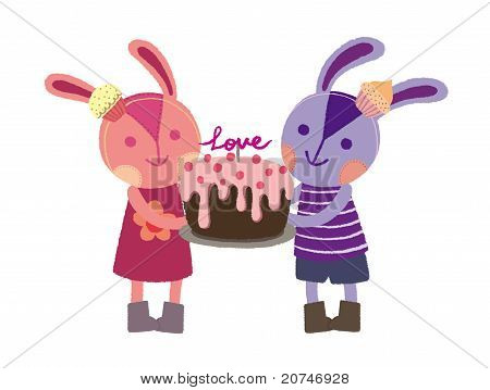 Two lovely rabbits with a birthday cake.