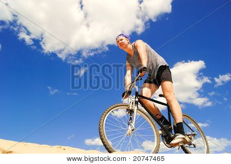 Young men  riding a bike