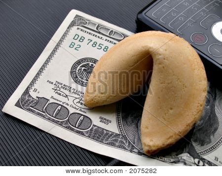 Close Up Shot Of Fortune Cookie On 100 Bill