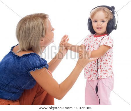 Little Girl Dancing With Headphones