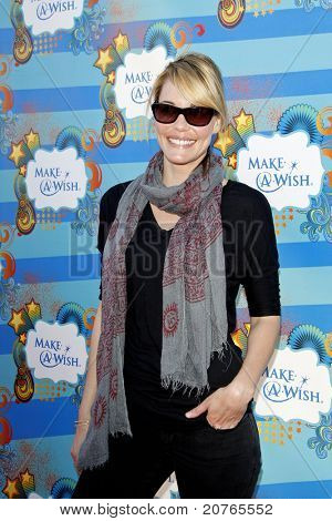 SANTA MONICA - MAR 14: Leslie Bibb at the Kevin + Steffiana James + Make-A-Wish Foundation Host A Day of Fun at the Santa Monica Pier in Santa Monica, California on March 14, 2010.