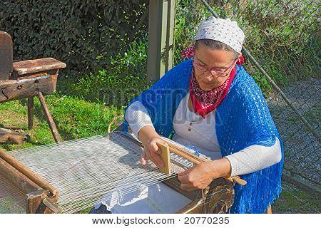 Woman Weaves On Old Loom