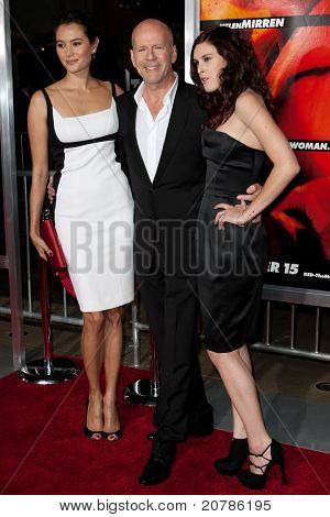 HOLLYWOOD, CA. - OCT 11: (L-R) Emma Heming, Bruce Willis & Rumer Willis arrive at the Los Angeles special screening of Red at Grauman's Chinese Theatre on Oct. 11, 2010 in Hollywood, California.