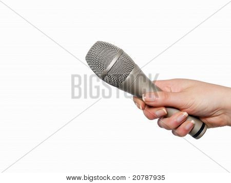 Hand holding microphone