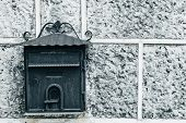 Dark Old Mailbox On An  Gray Stone Wall. Place For Text poster
