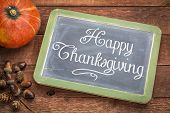 Happy Thanksgiving greeting card - white chalk text on a  vintage slate blackboard with winter squas poster
