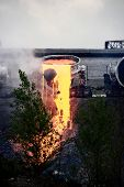 foto of slag  - drain slag carts at steel making plant - JPG