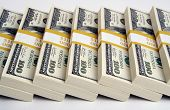 stock photo of money stack  - Stacks of One Hundred Dollar Bills in A Row - JPG