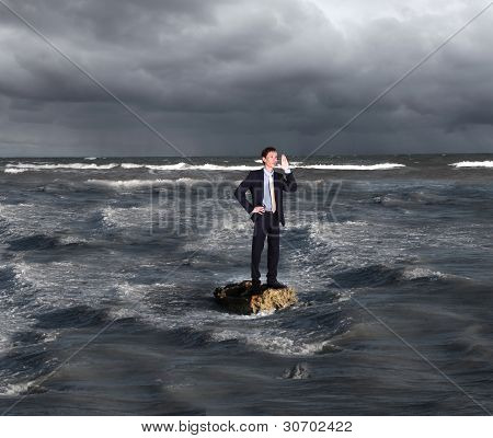 Businessman surfing on the sea waves
