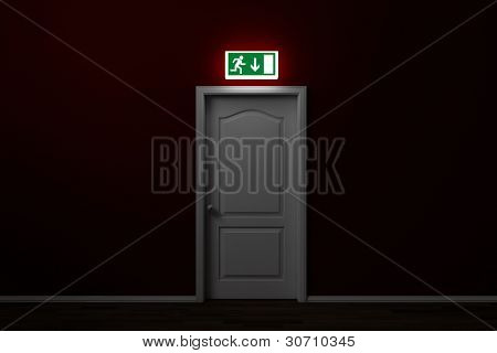 Emergency exit with glowing sign over door in a room