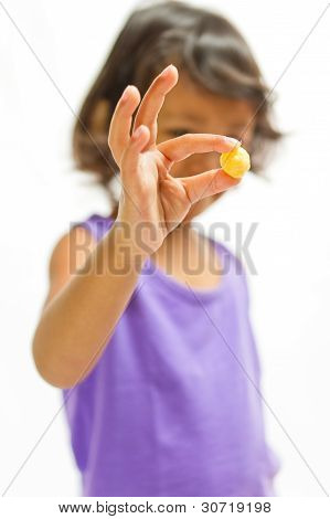 Asian Little Girl Showing A Snack on Hand