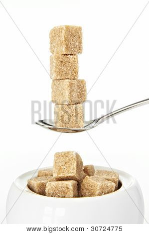 spoon full of sugarcubes closeup