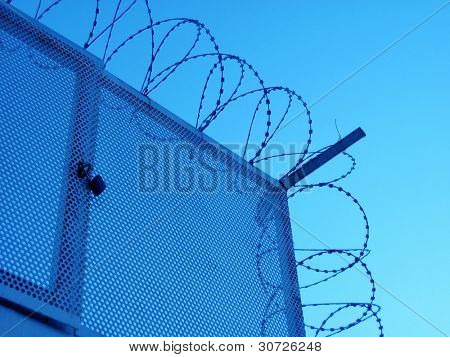 an image of barbed wire and blue sky