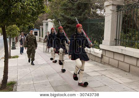 Royal guards moving along a street
