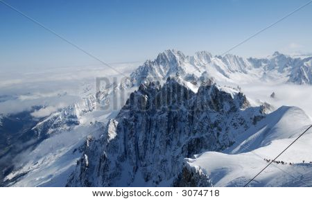 White Steep Alps And Snow Slope With Mountain-Skiers, Mont Blanc, France