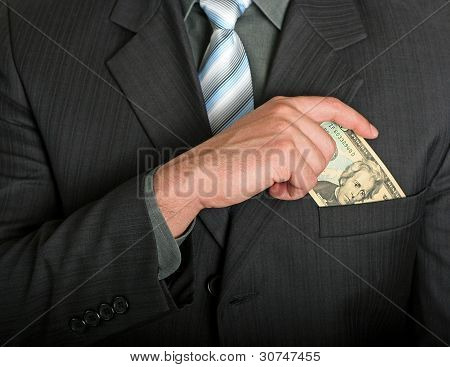 Businessman Putting A Dollar Bill In His Pocket