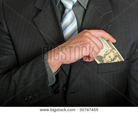 Businessman Putting A Dollar Bill In His Pocket