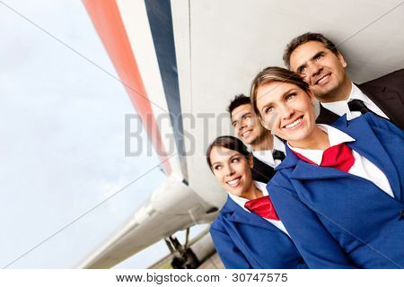 Airplane cabin crew at the airport smiling