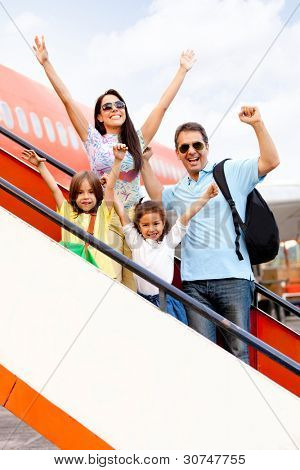 Happy family going on holidays and getting on the airplane