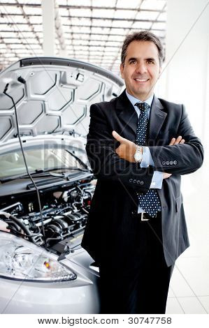 Business man at a dealership buying a car