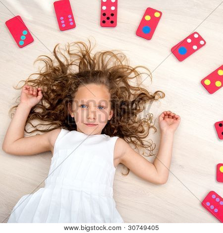 Young Girl On Floor With Domino Pieces