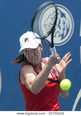 Jelena Jankovic of Serbia return ball to Petra Martic