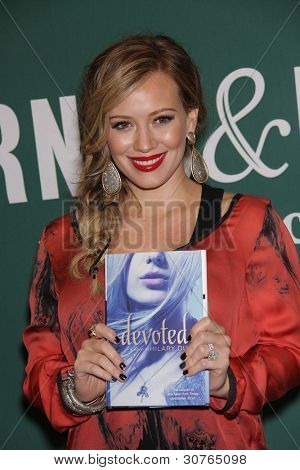 LOS ANGELES - OCT 14:  Hilary Duff Hilary Duff signs 'Devoted'  on October 14, 2011 in Los Angeles, CA