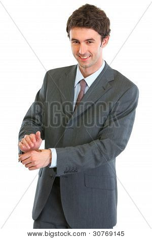 Modern Business Man Showing Tossed Coin