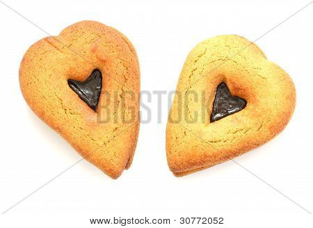 Two gingerbreads in heart shapes on white background