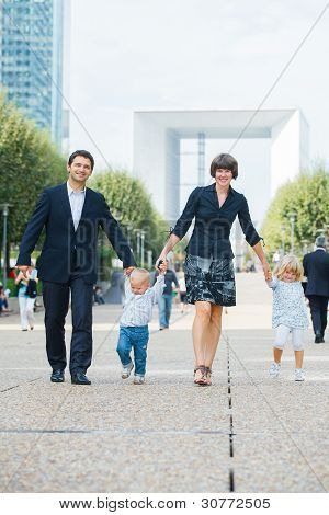 Family of four walking to city