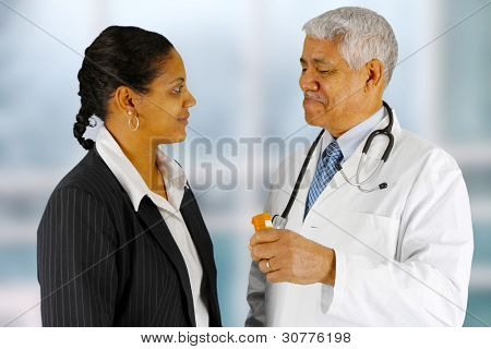 Man giving a prescription to his customer